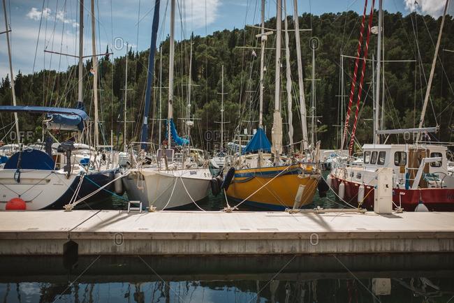 Sibenik, Croatia - May 14, 2016: Sailboats docked at marina in Skradin, Croatia