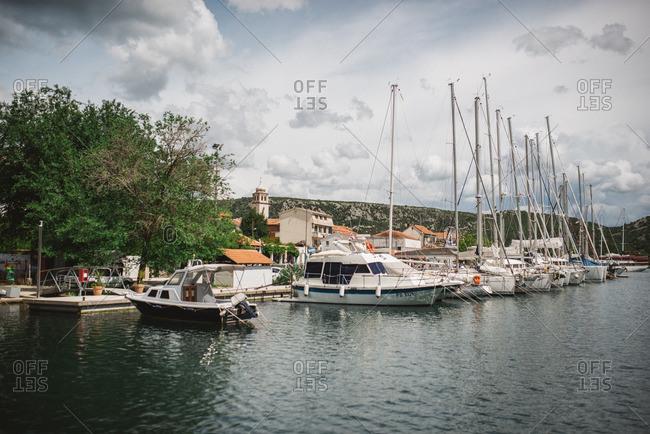 Sibenik, Croatia - May 14, 2016: Luxury yachts and sailboats at marina, Skradin, Croatia