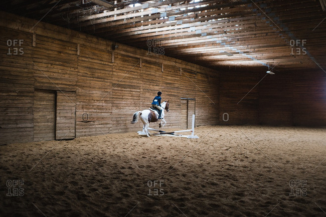 Girl jumping a horse in an equestrian competition