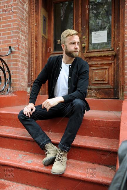 Bearded man on outside steps