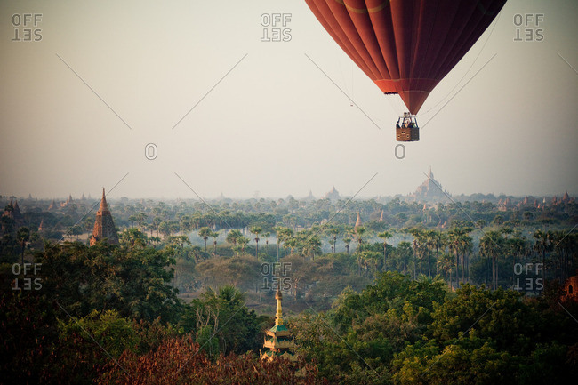 Hot air balloon flying over Bagan ancient city Kingdom of Pagan temples and pagodas, Myanmar
