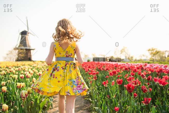 Girl walking among tulips