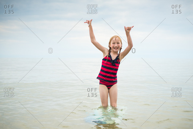 Smiling girl standing in water