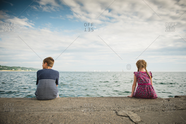Girl and boy on dock edge