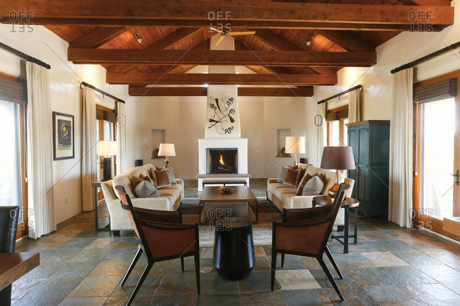 Santa Fe New Mexico, USA - June 10, 2016: Living room with slate tile floors and fireplace