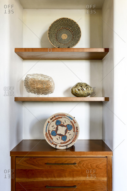 Alcove with wooden shelves and woven Southwestern baskets