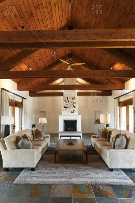 Santa Fe New Mexico, USA - June 10, 2016: Sofas in a living room with slate tile floors and fireplace
