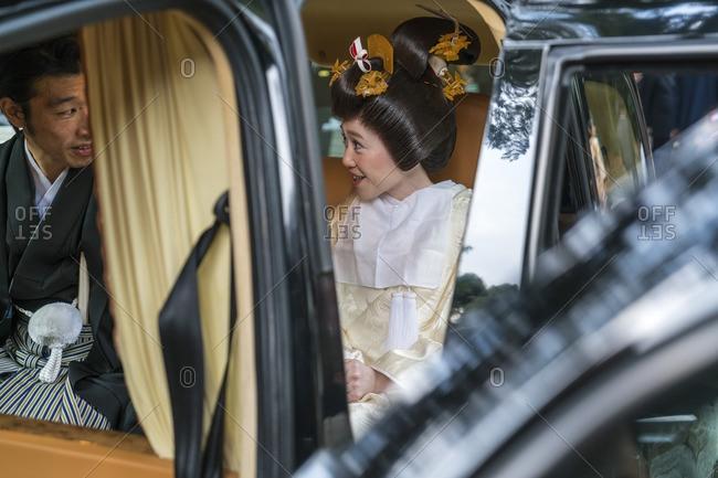 Bridal couple in car in Tokyo