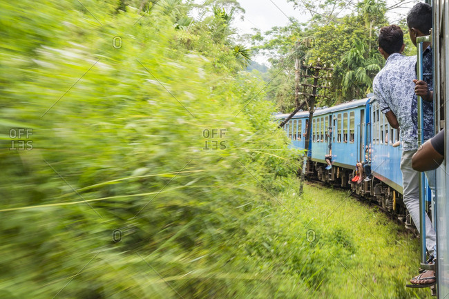 People leaning from train, Sri Lanka