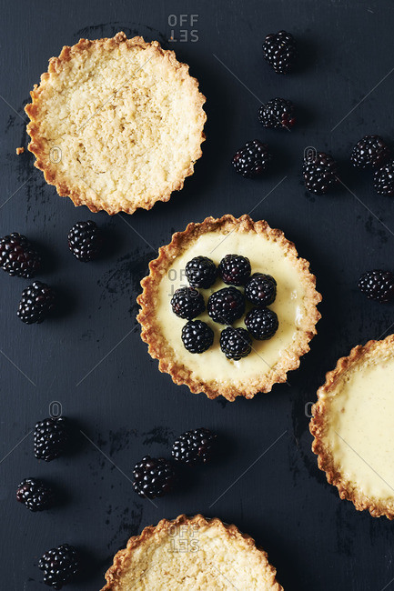 Fresh blackberry and vanilla custard tarts