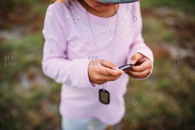 Little girl wearing military dog tags