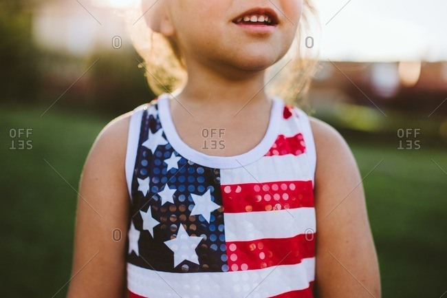 Little girl wearing American flag tank top