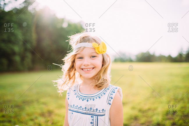 Portrait of girl wearing headband with yellow flower