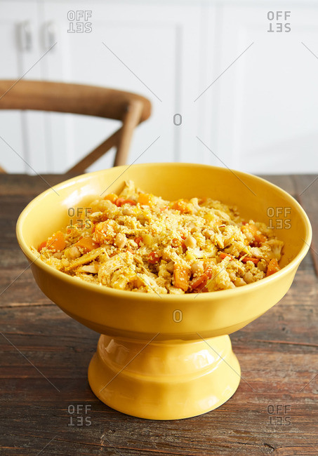 Bowl of couscous with chickpeas, chicken, and carrots