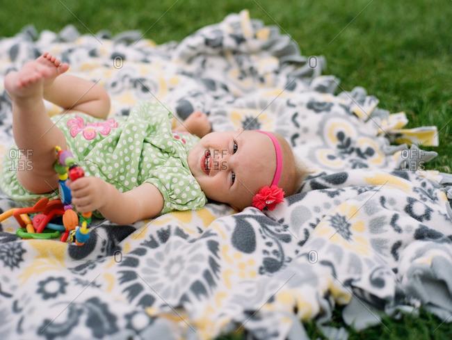 Smiling baby girl on blanket