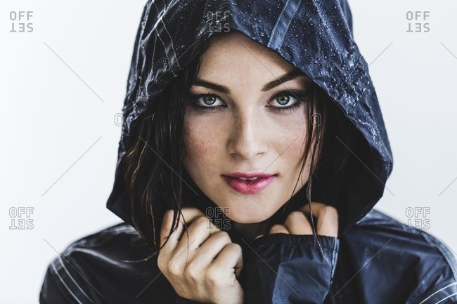 Woman with wet hair in hooded rain jacket