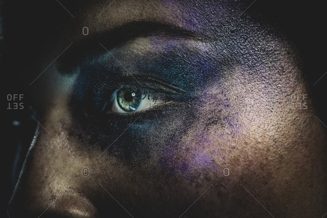 Close-up of woman's eye with smudged eye shadow