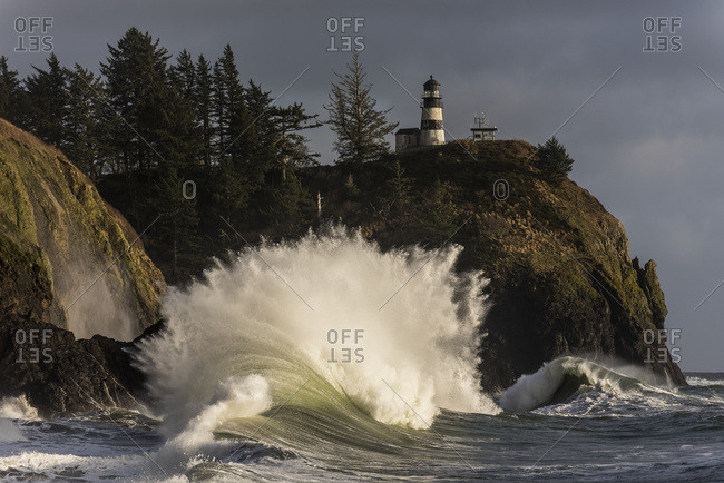 A wave explodes at Cape Disappointment