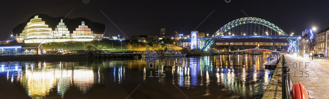 Newcastle, United Kingdom - November 30, 2015: Tyne Bridge illuminated at nighttime over River Tyne and illuminated buildings