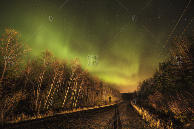 Aurora borealis over road