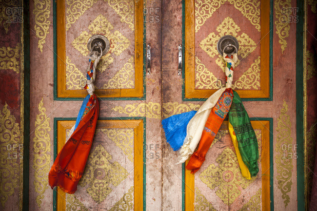 Cloth is braided together to create a decorated door pull on the doors on a Tibetan style monastery