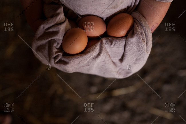 Girl carrying three eggs in dress
