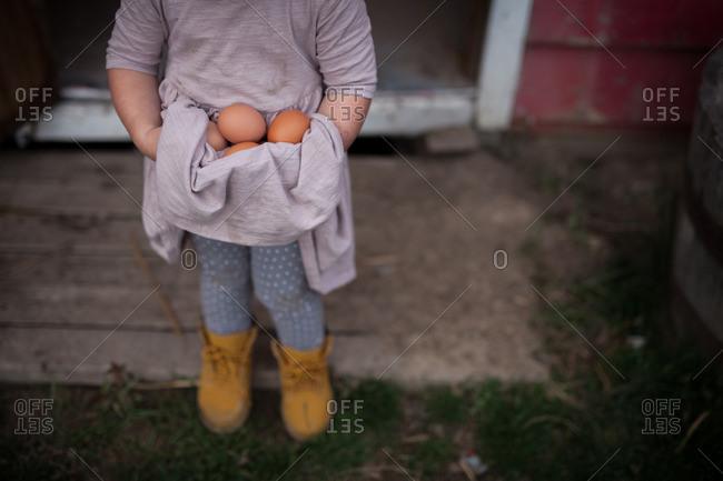 Girl holding eggs in dress