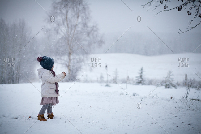 Girl standing in a the snow