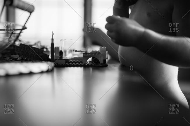 Child playing with interlocking blocks