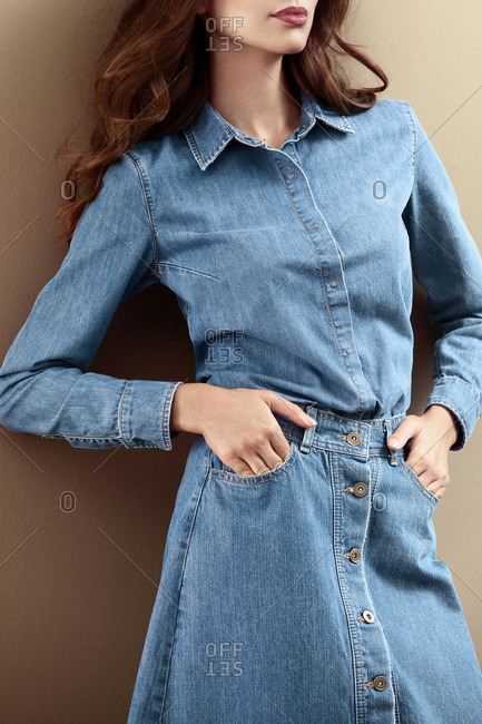 Woman in a denim skirt and shirt