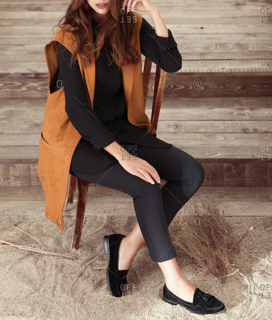 Elevated view of woman modeling a suede vest