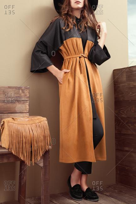 Woman in a western-style long coat