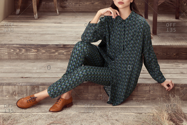 Woman in matching patterned tunic and pants