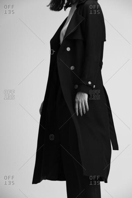 Woman wearing an open belted trench coat