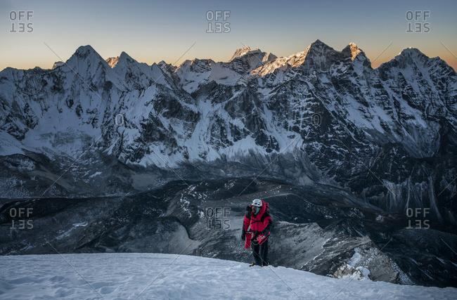 Nepal, Himalaya, Solo Khumbu, mountaineer at Ama Dablam South West Ridge at twilight