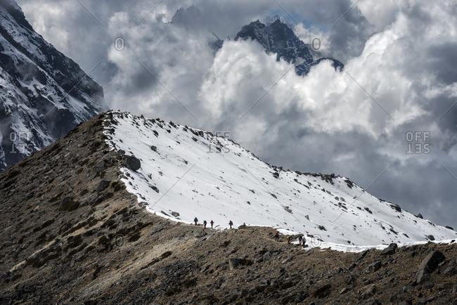 Nepal, Himalaya, Solo Khumbu, Ama Dablam, group of Gurkhas trekking on ridge