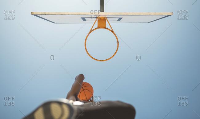 Young man aiming at basketball hoop