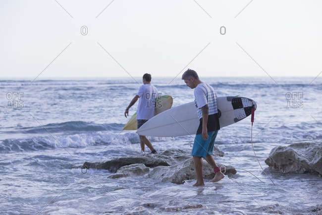 Indonesia, Bali, Surfers going into the water