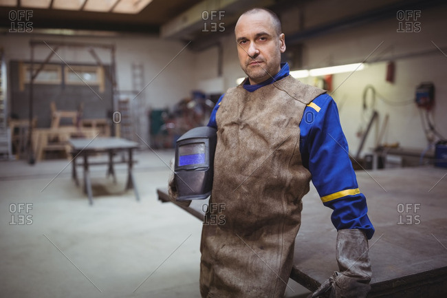 Welder looking at the camera in the workshop