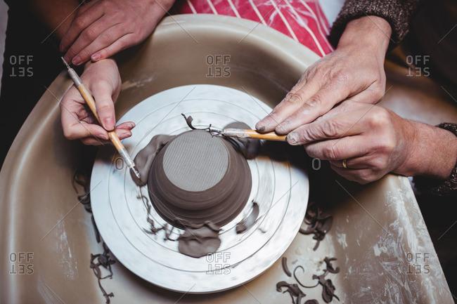 Hands of potters working in workshop