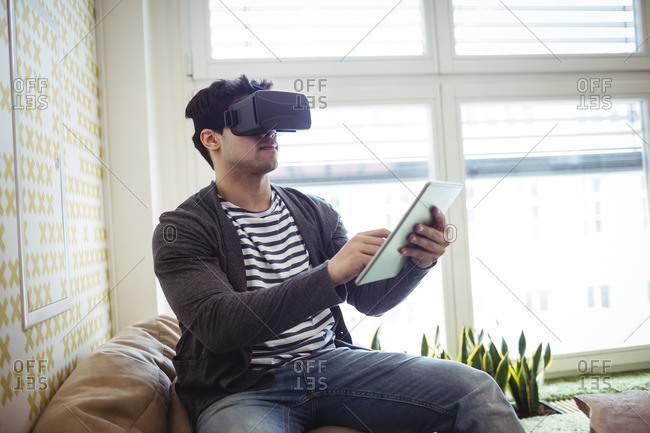 Photo editor using virtual reality simulator and digital tablet in office