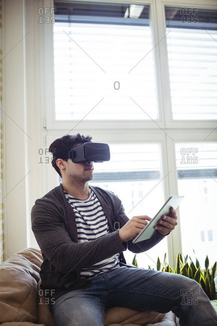 Photo editor using virtual reality simulator with digital tablet in office