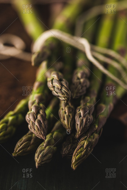 Close-up of fresh asparagus tied with string