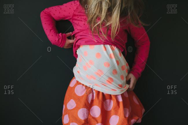 Little girl in polka dot shirts and skirt