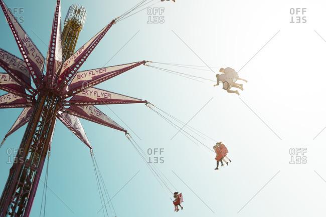 Melbourne, Australia  - September 26, 2015: People on a swinging amusement park ride