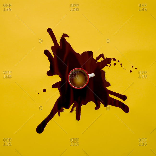 Spilled coffee on a yellow background
