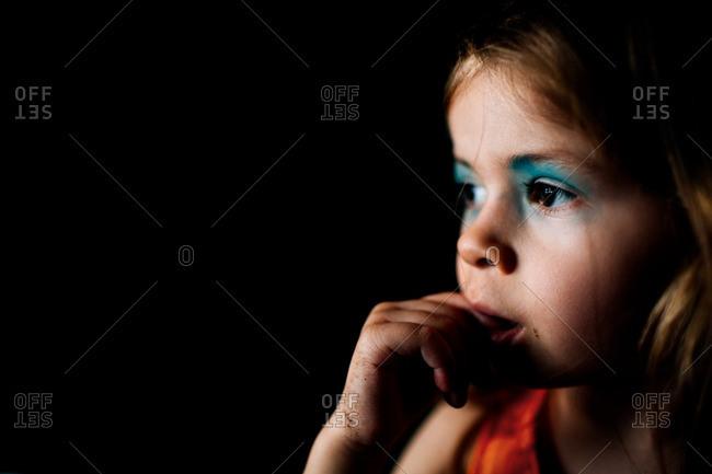 Girl with eye shadow crying