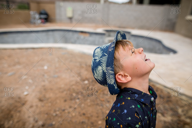 Close up of boy looking up on a sunny day
