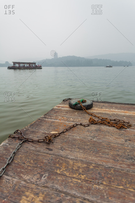 An improvised anchor sits on a water taxi which takes tourists on trips across West Lake in Hangzhou, China