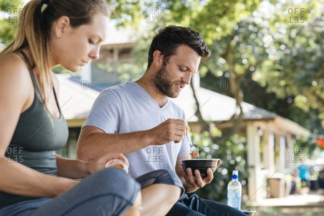 Couple eating in neighborhood setting